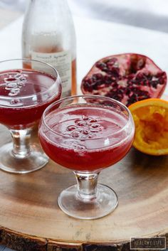 Pomegranate Orange Sparkler a fruity, tart, bubbly cocktail perfect for toasting and jump starting your party fun. - A Healthy Life For Me Fancy Drinks, Fun Cocktails, Yummy Drinks, Cocktail Recipes, Drink Recipes, Classic Cocktails, Pomegranate Drinks, Pomegranate Seeds, Homemade Wine