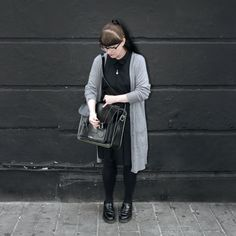April, Senior Accessories Designer, wears the Adrian shoe in black.