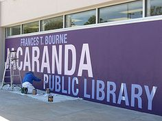 Jacaranda Library's sign gets a purple facelift. by Sarasota County Libraries
