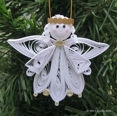 Unique, beautiful, handmade quilled angel ornament. New to Quilly Nilly, this angel was created from strips of paper that have been rolled and shaped