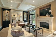 Coffered ceiling in living room mixed with dark cabinetry.