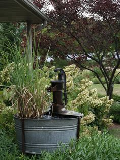 Water fountain. We had one like this in the back yard as a kid, but it had fish in the whiskey barrel below.