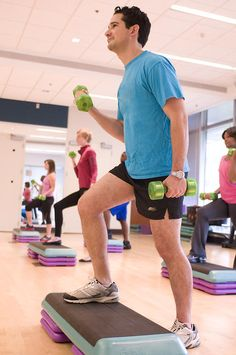 Health and Fitness Club: Men And Women Performing Aerobic Exercises.