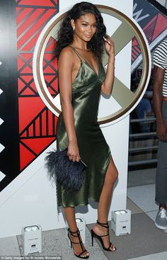 Dreamy: She teamed the olive green frock with strappy black heels which added some extra h...