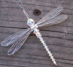 ❥ Dragonfly sun catcher... this would be easy to make... :)