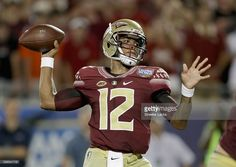 Deondre Francois #12 of the Florida State Seminoles drops back to pass against…