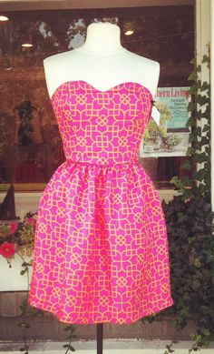 Love this dress. Bright Spring. With a very light, pretty cardigan style top.