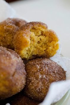 Baked Pumpkin Spice Donut Holes - Technically, these are miniature muffins but after rolling them in the buttery cinnamon sugar mixture, they magically turn into cakey, sugary donut holes..