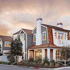 This Cape Cod inspired stunner has curb appeal from all angles!