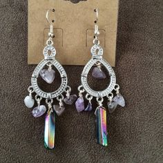 Amethyst and titanium Quartz chandelier  earrings One of my favorite pairs I've created! from my BellaFaith Jewelry line! These earrings are amethyst and titanium Quartz! So gorgeous on!! Usually $35 , offering to my posh ladies for $25. These are one of a kind and so stunning ✨ BellaFaith Jewelry Jewelry Earrings