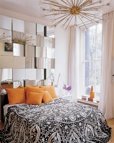 So cool! Between the color scheme used here and the modern, eclectic look of the light and the mirrored wall, this is to die for.