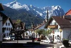 Garmisch, Germany - September 2006. Beautiful colorful homes and gorgeous draping flower boxes.