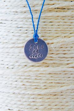 Joie de Vivre necklace, waxed cord, turquoise by InkandfeatherbyKerry on Etsy