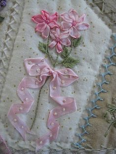 just beautiful - ribbonwork embroidery flower on a crazy quilt patch - love the way the cascading ribbon is tacked down ******************************************** (repin) #embroidery #ribbonwork