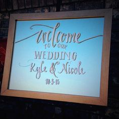 Welcome wedding sign on mirrors with white and gold writing