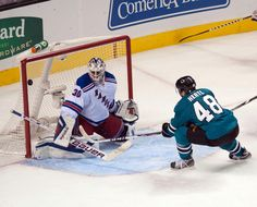 San Jose Sharks rookie forward Tomas Hertl deflects the puck past New York Rangers goaltender Henrik Lundqvist for a goal in the second period (Oct. 8, 2013).