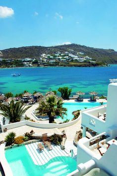 Panoramic view of Kivotos Luxury Hotel in Mykonos.More than just a Boutique Hotel in Mykonos Greece, the Kivotos Hotel, was not destined originally to become one of the best hotels in Mykonos, for it was meant to be a family villa. What is now considere Dream Vacations, Vacation Spots, Mykonos Grecia, Mykonos Island Greece, Places Around The World, Around The Worlds, Places To Travel, Places To Visit, Mykonos Hotels