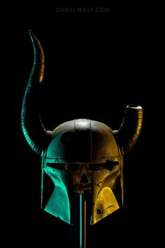 """Volpin Props did this incredible """"DovahFett"""" helmet, which is a Skyrim-based Boba Fett helmet, pitted, rusty & perfectly aged."""