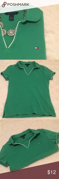 "Tommy Hilfiger Polo This uber preppy polo looks great dressed up or down. It's a flattering Kelly green color and is in excellent condition. Runs small.  💠 100% cotton 💠 MEASUREMENTS: 22"" long; 16.5"" bust, 15"" waist 💠 Smoke free home 💠 Please ask any questions and feel free to make an offer! Tommy Hilfiger Tops"