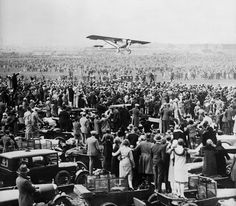 """May 21, 1927, Charles Lindbergh lands in Paris' Le Bourget Field. As a 25-year-old U.S. Air Mail pilot, Lindbergh was the first person to do a solo non-stop flight across the Atlantic.  The day before he left from Roosevelt Field located in Garden City on New York's Long Island in his single-seat, single-engine Ryan monoplane """"Spirit of St. Louis""""."""