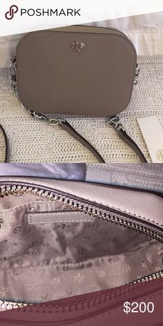 """Authentic TB Robinson round cross-body bag A gorgeous cross-body bag in French gray saffiano leather with silver hardware, removable shoulder strap with a 23.3"""" drop, zip around closure, logo stud at top center, logo jacquard lining with a slip pocket inside. Perfect for spring and summer! Tory Burch Bags Crossbody Bags"""