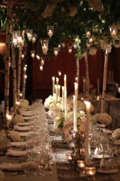 Romantic bridal table at Union League. Candles hang from arbor created with birch branches and fabulous spring flowers such as peonies and hydrangea . Nancy Saam Flowers