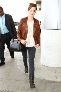 Emma Watson: brown leather jacket + + sweater +  combat boots