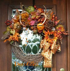 Fall Grapevine Wreath with ANTLERS FEATHERS PUMPKINS by decoglitz