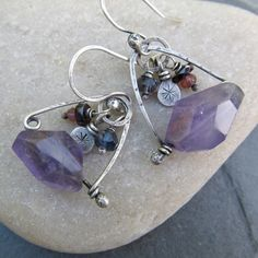 wire wrapped earrings sterling silver dangling gemstone Purple Charms. $78.00, via Etsy.