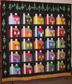 """2004 Raffle Quilt  """"House of Many Colors"""".  The pattern was taken from Freddy Moran's book """"Freddy's House: Brilliant Color in Quilts""""."""