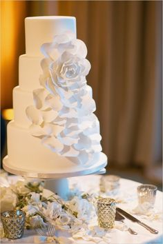 This white rose wedding cake is immensely and romantically beautiful!