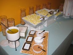 Popcorn station with clarified butter and seasoned salts.