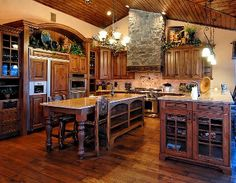 Elegant Gourmet Kitchen with Granite Counter-tops, Island, wood flooring and ceiling. Beautiful! http://amiebozeman.com