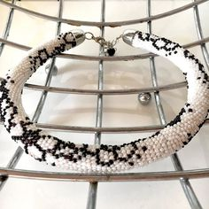 Black and white bead crochet necklace! Floral pattern glass beads . Available for sale http://ift.tt/2gy1u1u  #etsyforsale #necklaceforsale #jewelryforsale #forsale #handmadeforsale #etsy #necklace #handmadejewelry #handmadenecklace #handmadelover #blackandwhite #glass #beads #crochet #collar #designer #jewelrydesign #jewelrymaker #giftsforher #giftideas