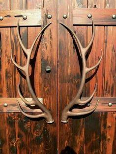 Antler door handles on rustic doors