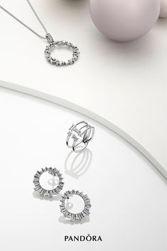 Add an elegant twist to your jewelry collection with these Pandora celestial-inspired designs in sterling silver. Make a statement with the Shards of Sparkle open ring or let the baguette-cut stone necklace orbit around your neck day and night. Jewelry Stores, Jewelry Sets, Jewelry Accessories, Jewelry Design, Jewelry Rings, Pandora Bracelets, Pandora Jewelry, Pandora Charms, Photo Jewelry