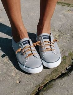 """The Sperry Seacoast Canvas Sneaker, worn by @karenbritchick - """"These knotted sneakers are comfortable and stylish, adding an on-trend grey to this neutral, daytime look. Plus, they slip on and off easily."""""""