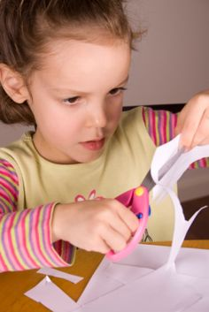 Teaching preschooler to use scissors - visit http://yourtherapysource.com/cuttingcards.html for Cutting Cards