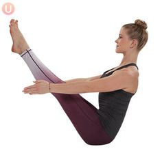 Chloe Freytag demonstrating boat pose in a black tank top and yoga pants