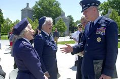 Joint Chiefs Chairman Gen. Richard Myers, right, talks to World War II WASP's (Women Airforce Service Pilots) Lorraine Rodgers, left, and Elaine Harman at the Women's Memorial at Arlington National Cemetery in Arlington, Va., May 22, 2002 after a wreath laying ceremony in honor of women who have died in service to the U.S.