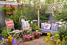 My Painted Garden: Outdoor seating area with colorful annuals, birdhouses, and painted sign