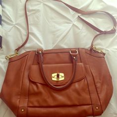 Merona Cognac Purse Detachable cross body strap. Good to great used condition. Gold plate on front has some scratching from clasp. Interior is fairly clean with a few small spors from my bottle of Diet Coke leaking a bit (was cleaned & sanitized after that.) zipper works but is persnickety some times. Merona Bags Crossbody Bags