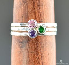 **15% off entire store! Use coupon: 15OFF & 5 Golden Ring Sale: http://etsy.me/2fzs2in $15 off** **Free Domestic Shipping for all orders over $50! Use Coupon Code: SHIPFREE50.**  Set of 3 Dainty Mothers / Birthstone Rings. The set is beautiful, simple, rustic, and very stylish. A lovely way to add subtle color & sparkle.  - Delicate, high quality Pure Silver band and bezel. - 3mm Lab grown gemstones. Natural Stones Available. - Delicate hand-hammered texture. - Made to order, just for you…