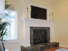 proportions Custom wood fireplace with slate tile hearth and inset flat screen ...