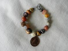 Buddha Bracelet (Vintage Thai Buddha amulet, Agate Beads, Tiger's Eye, Vintage Carved Bone Rose Bead, African Skunk Bead, Cast Brass Ghana Bead, Tibetan Wooden Buddha Bead, Krobo Powdered Glass Bead, Hematite)