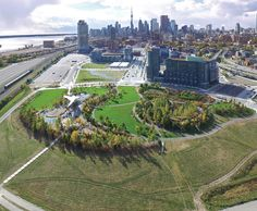 Corktown Common borders the Canary District, a mixed-use development that initially housed athletes during the 2015 Pan Am/ParaPan Am Games. The park incorporates a raised landform that protects the eastern part of downtown (including the Canary District) from flooding.