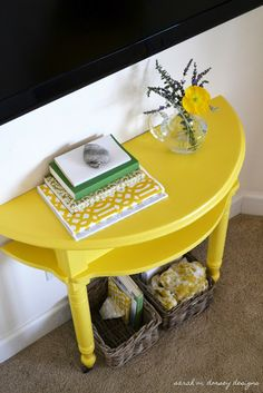 sarah m. dorsey designs: DIY If you can't find a half moon table just cut a round one in half and mount to wall with L brackets