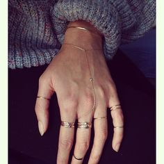 What a great look that upgrades a simple sweater outfit: a gold hand chain and some delicate gold stacked rings. New Balenciaga, Jewelry Accessories, Fashion Accessories, Hand Chain, Midi Rings, Diamond Are A Girls Best Friend, Modern Jewelry, Body Jewelry, Hand Jewelry