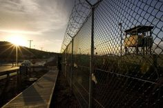 In this image reviewed by the US Military, The sun rises over Camp Delta detention compound which has housed foreign prisoners since 2002, at Guantanamo Bay US Naval Base, June 6, 2008 in Cuba. Khalid Sheikh Mohammed, the accused mastermind of the attacks on September 11, 2001 and four alleged conspirators faced a military judge in Guantanamo June 5, in their first appearance before a war-crimes tribunal.  (Photo: BRENNAN LINSLEY/AFP/Getty Images)