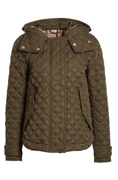 Diamond quilting and military inspired details make this gorgeous green Burberry Brit jacket the perfect cold weather staple.